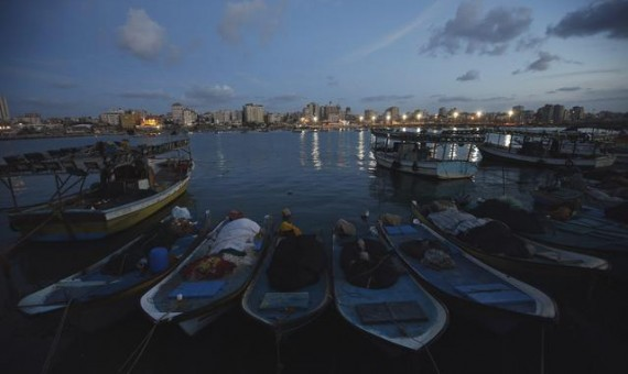 epa04645045 A picture made available on 03 March 2015 shows boats of Palestinian fishermen moored at Gaza port after sunset, west of Gaza City, 02 March 2015.  EPA/MOHAMMED SABER